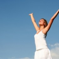 Woman feels free with arms in air