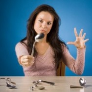 Woman bends spoon with her mind