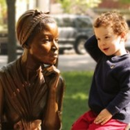 Kid starting conversation with statue